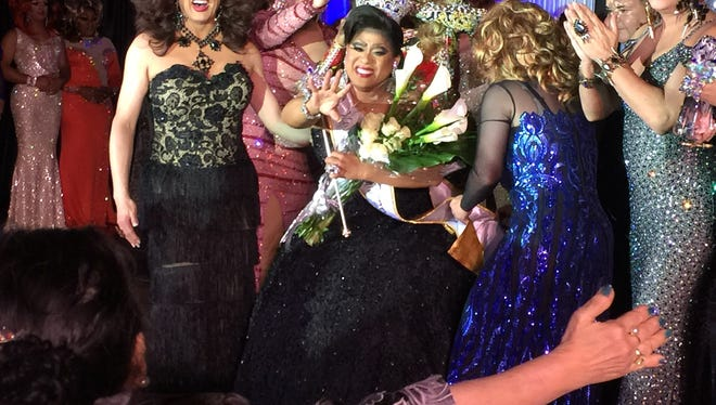 Suzy Wong (Arnold Myint) waves to his mother in the front row as he is crowned Miss Gay America 2017 at a pageant in Memphis on Oct. 9, 2016.