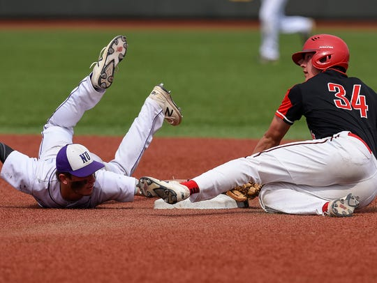 Rocori's Matt Koshiol slides safely around the tag by New Ulm T.J. Sweere, stealing second in the second inning Friday, June 15, at Dick Siebert Field in Minneapolis.