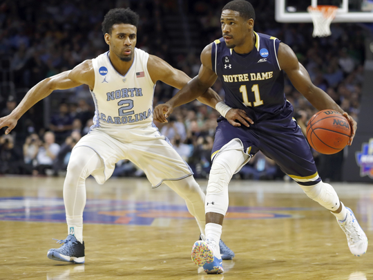 Notre Dame's Demetrius Jackson, right, dribbles past North Carolina's Joel Berry II during the first half of a regional final men's college basketball game in the NCAA Tournament, Sunday, March 27, 2016, in Philadelphia.