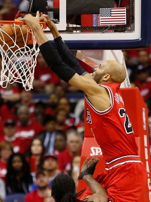 Bulls forward Taj Gibson dunks on the Wizards in Game 3 of their first-round series.