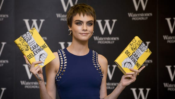 Cara Delevingne attends the signing of her debut novel