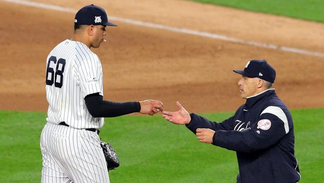 Yankees manager Joe Girardi pulls relief pitcher Dellin Betances (68) from the game during the ninth inning against the Houston Astros during Game 3 of the 2017 ALCS at Yankee Stadium.
