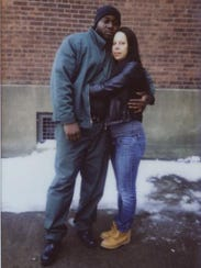 A family photo shows Samuel Harrell, 30, with his wife,