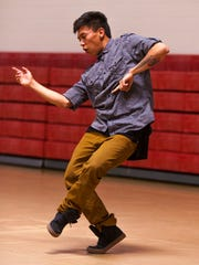 Amadeo Wauneka performs an improvised dance at the