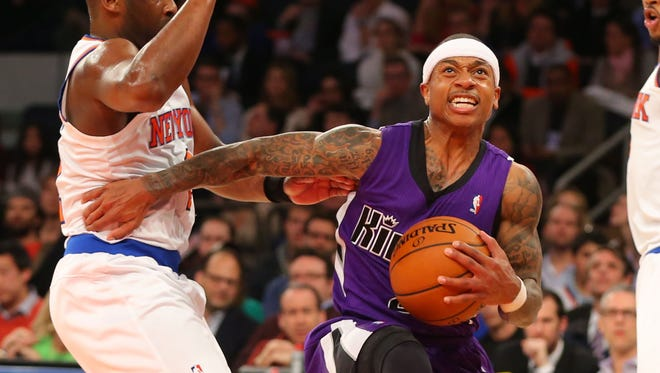 Sacramento Kings point guard Isaiah Thomas (22) drives to the basket during the first half against the New York Knicks at Madison Square Garden.