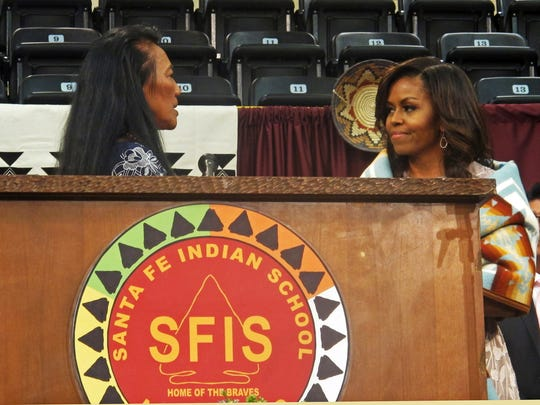 Santa Fe Indian School Principal Felisa Gulibert, left, thanks first lady Michelle Obama for her commencement address to the school's graduates in Santa Fe, N.M., Thursday, May 26, 2016.
