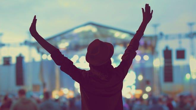 Girl enjoying the music festival / concert.
