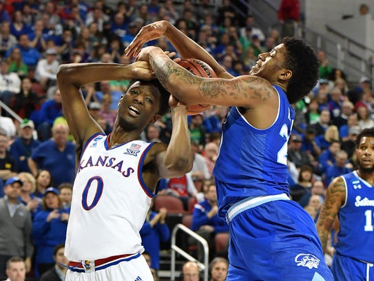 Kansas Jayhawks guard Marcus Garrett (0) battles for