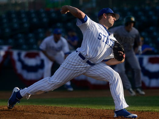 Adam Bray pitches for SDSU as they play NDSU Thursday night at the Summit League baseball tournament at Sioux Falls Stadium, May 22, 2014.