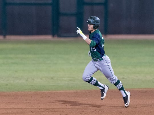 El Diamante's Andrew Valdez jogs out a home run against
