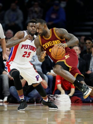 The Cavaliers' LeBron James drives against the Pistons'' Reggie Bullock on Tuesday night.