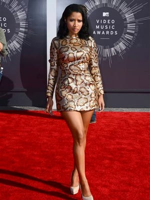 Nicki Minaj arrives at the MTV Video Music Awards at The Forum on Sunday, Aug. 24, 2014, in Inglewood, Calif.