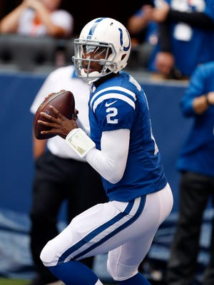 Indianapolis Colts quarterback Josh Johnson (2) warms up before the game against the Jacksonville Jaguars at Lucas Oil Stadium.
