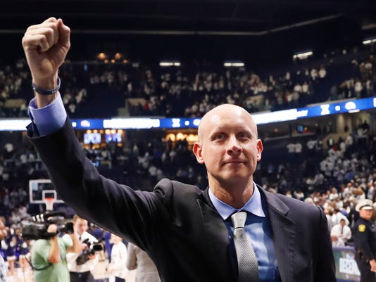 FILE - In this Dec. 2, 2017, file photo, Xavier head coach Chris Mack celebrates after an NCAA college basketball game against Cincinnati, in Cincinnati. The Xavier Musketeers have had a couple days to get used to the idea of being a No. 1 seed for the first time in program history before turning their attention to starting play in the West Region of the NCAA Tournament.  (AP Photo/John Minchillo)
