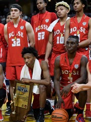 The Bosse Bulldogs react to their lose 64-49 loss against the Culver Academies Eagles in the IHSAA Class 3A State Championship at Bankers Life Fieldhouse in Indianapolis, Saturday, March 24. The team ended their season as Class 3A Runner-Ups with a 25-5 record.