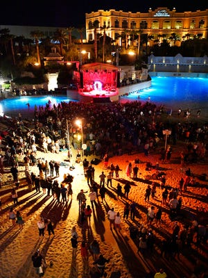 Gathered in the sand the audience listens as Chris Young the plays ACM Party for a Cause: WME's Bash at The Beach on Saturday, April 14, 2018 in Las Vegas, NV