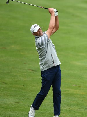 Steve Stricker hits his second shot on the 18th hole during the first round of the American Family Insurance Championship at University Ridge in Madison.