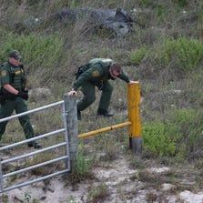 FALFURRIAS, TX - JULY 25:  U.S. Border Patrol agents chase undocumented immigrants through ranchland on July 25, 2014 near Falfurrias, Texas. Tens of thousands of illegal immigrants have crossed into the U.S. this year, causing a humanitarian crisis on the U.S.-Mexico border. Texas' Rio Grande Valley has become the epicenter of the latest immigrant crisis, as more Central Americans have crossed illegally from Mexico into that sector than any other stretch of America's 1,933 mile border with Mexico.  (Photo by John Moore/Getty Images)