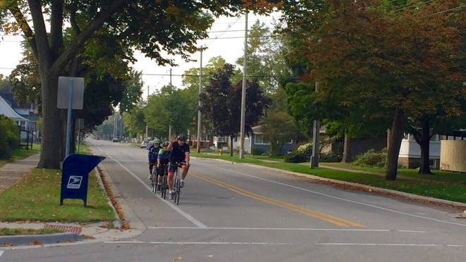 Bikers use the lanes on Central Avenue in Holland on Sept. 24. The city has proposed adding bike lanes to the road and eliminating parking on the south side of 10th Street to make room for the bike lanes.