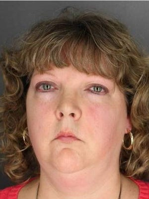 Rebecca Evans of Norwich is accused of stealing from the Norwich Purple Tornado Community Team, of which she was the treasurer.