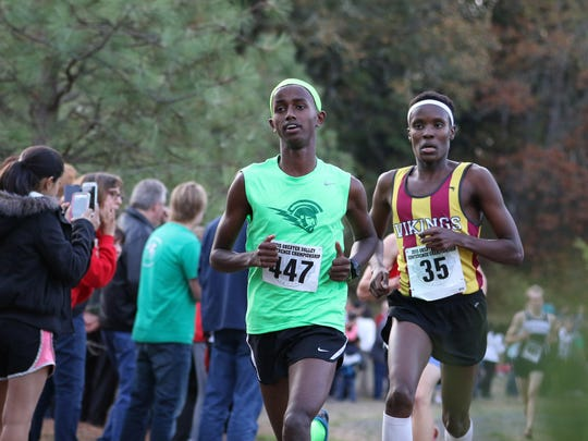West Salem's Ahmed Muhumed wins the boys varsity race with a time of 15:17 during the Greater Valley Conference District Cross Country meet Wednesday, Oct. 21, 2015, at Bush's Pasture Park in Salem.