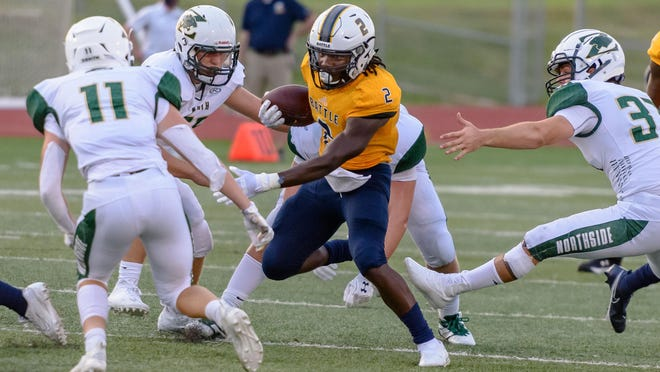 Battle's Gerry Marteen (2) carries the ball through traffic during a game against Fort Zumwalt North on Friday night at Battle High School.