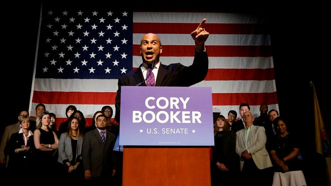Newark Mayor Cory Booker talks to supporters during an election night victory party.