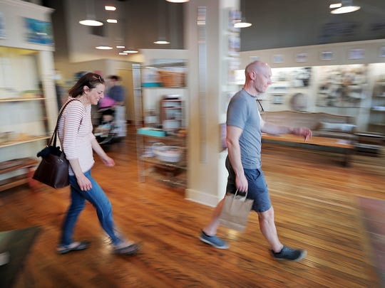 Shoppers peruse the new pop-up B Collective store downtown.