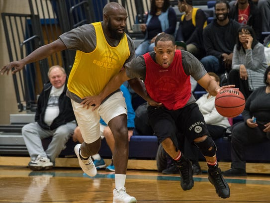 A player tries to maneuver around defenders during