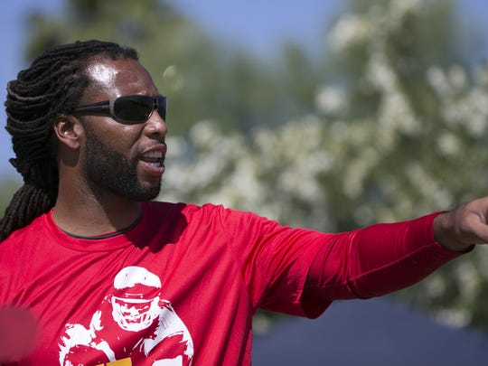 Cardinals' Larry Fitzgerald instructs children at the Larry Fitzgerald Football Procamp on May 8, 2016 in Tempe, Ariz.