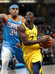 Indiana Pacers guard Darren Collison (2) drives on LA Clippers forward Tobias Harris (34) in the first half of their game at Bankers Life Fieldhouse on Friday, March 23, 2018.