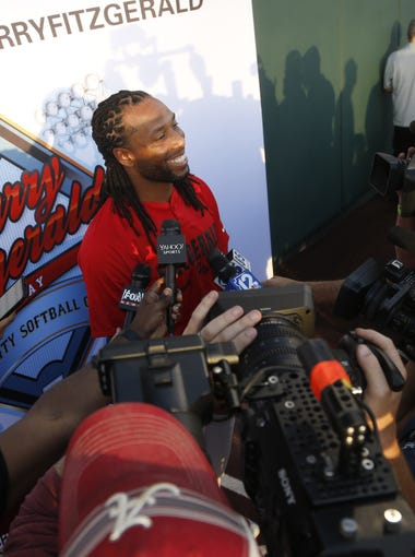 Larry Fitzgerald answers questions from the press before the Larry Fitzgerald Celebrity Softball game at Salt River Fields in Scottsdale, Ariz. on April 21, 2018.