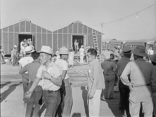 Japanese-Americans arrive at an internment camp in