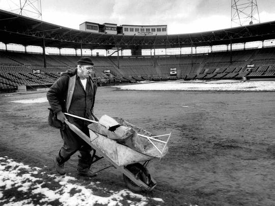 Dick Sierens prepares the field at Silver Stadium for