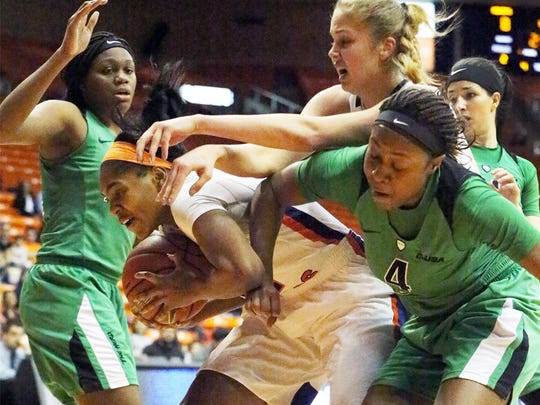 UTEP guard Sparkle Taylor protects the ball from Khadaijia