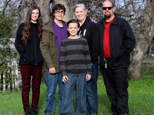Ronda Snyder, second from right, and her fiancee Mike White, right, at their  home with Snyder's daughter Kaitlyn Weller,15, from left, and White's sons, Kaden, 14, and Kyler, 11.