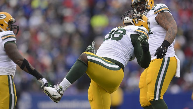 Green Bay Packers defensive tackle Letroy Guion (98) reacts after making a tackle in the first quarter during Sunday's game against the Buffalo Bills at Ralph Wilson Stadium in Orchard Park, N.Y.