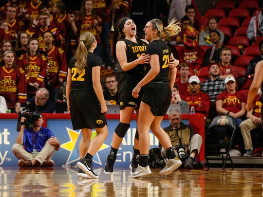 Members of the Iowa women's basketball team react after an Iowa State foul on Wednesday, Dec. 6, 2017, at Hilton Coliseum in Ames.