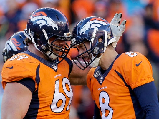 Denver Broncos kicker Brandon McManus, right, celebrates after a field goal with Evan Mathis during the first half in an NFL football divisional playoff game against the Pittsburgh Steelers, Sunday, Jan. 17, 2016, in Denver. Mathis won a Super Bowl with the Broncos. (AP Photo/Joe Mahoney)
