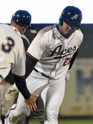 Aces' Yasmany Tomas, right, slaps hands with coach