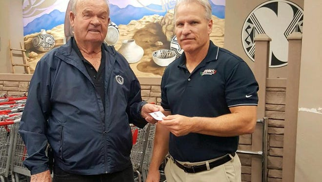 "At left, Don Hill, board member for the Cancer Support of Deming and Luna County Inc., hands Peppers Supermarket manager Kevin Ferraro his ticket to the ""I Hope You Dance Ball. The dinner and dance kick's off the fundraising season for Cancer Support."