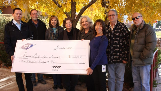 Dr. Bruce Martin, NMSU-Alamogordo; Joan Griggs, festival director;  Donna Cook, NMSU Alamogordo; Jan Wafful, Otero County Film Liaison; Jim Mack, Director of the Flickinger Center for Performing Arts, and Bryan Yancey, ProTech division head at NMSU Alamogordo Front row holding the check are TDS representatives, Stephen Leyva and Barbara Mick and TDS Marketing Director Barbara Mick.