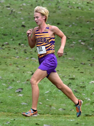 Hagerstown's Mason Bledsoe leads the TEC Cross Country boys race Saturday, Oct. 1, 2016 in Union City.