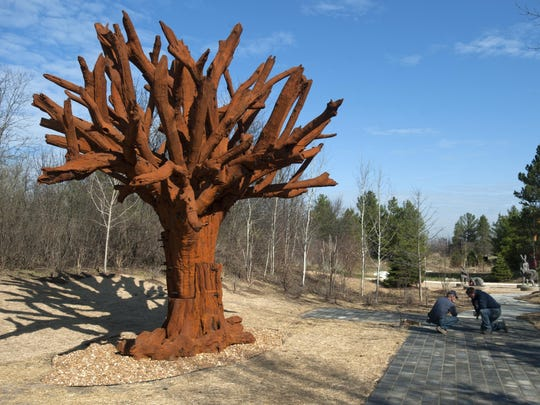 'Iron Tree,' a sculpture by Chinese artist and dissident Ai Weiwei, is ready to be unveiled during Frederik Meijer Gardens & Sculpture Park's 20th anniversary celebration in Grand Rapids, Mich.
