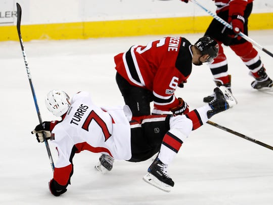 Senators center Kyle Turris (7) and Devils defenseman Andy Greene (6) collide while competing for the puck during the third period of Thursday's game. The Senators won 3-0.