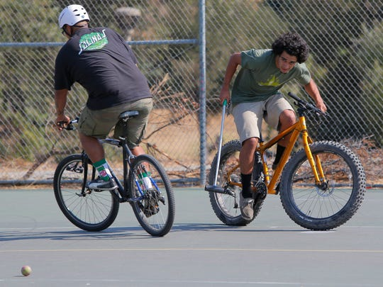 Edwin Nolasco, 23, and Rogelio Rodriguez, 22, play bike polo Wednesday at Natividad Creek Park in Salinas.