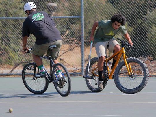 Edwin Nolasco, 23, and Rogelio Rodriguez, 22, play bike polo Wednesday at Natividad Creek Park in Salinas.