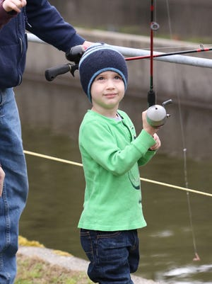 The Poggie Club of Kitsap County held its annual Kids Fishing Day Saturday on the opening day of lake fishing at Jarstad Park hatchery in Gorst.  Hundreds of pint-sized anglers with their parents in tow tried their luck at landing one of the 1,200 fish planted by the Poggie Club for the event.