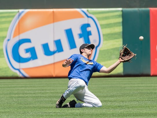 Oliver Campbell makes a sliding catch during the Carpenter