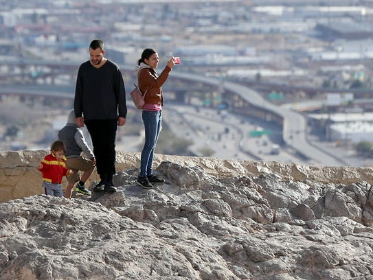 Antonio Valencia, left, and family visit scenic point on Scenic Drive.